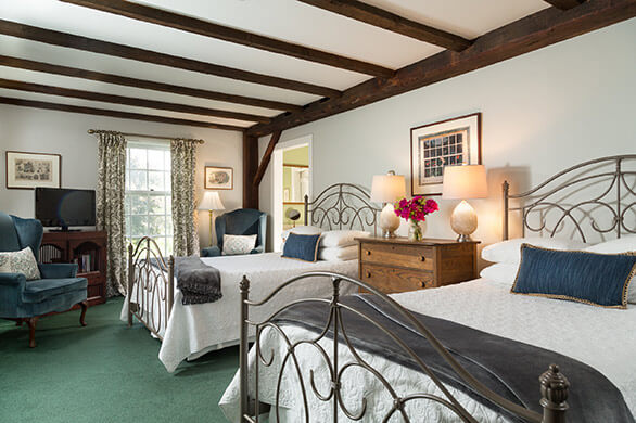Room 11 at the Chesterfield Inn with two beds and a sitting area