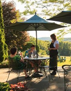 A couple enjoys a nice breakfast on a back patio