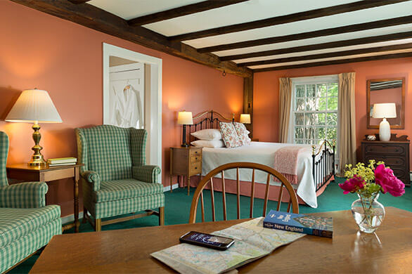 A sitting area near a bed in room 12 at the Chesterfield Inn