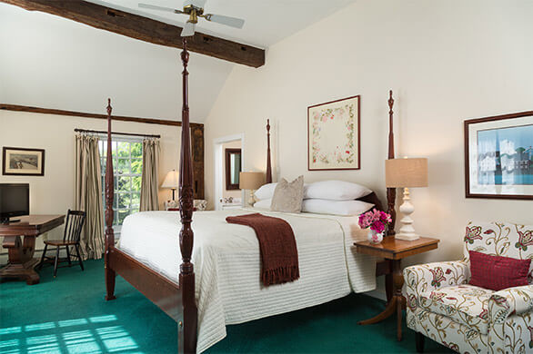 A spacious room with comfortable four-poster bed in room 16 at the Chesterfield Inn