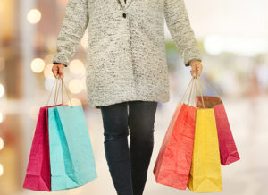 Person shopping with bags