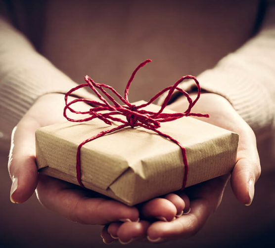 Hands holding a small gift box