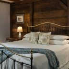 Soft bed in Room 10 with wooden feature wall