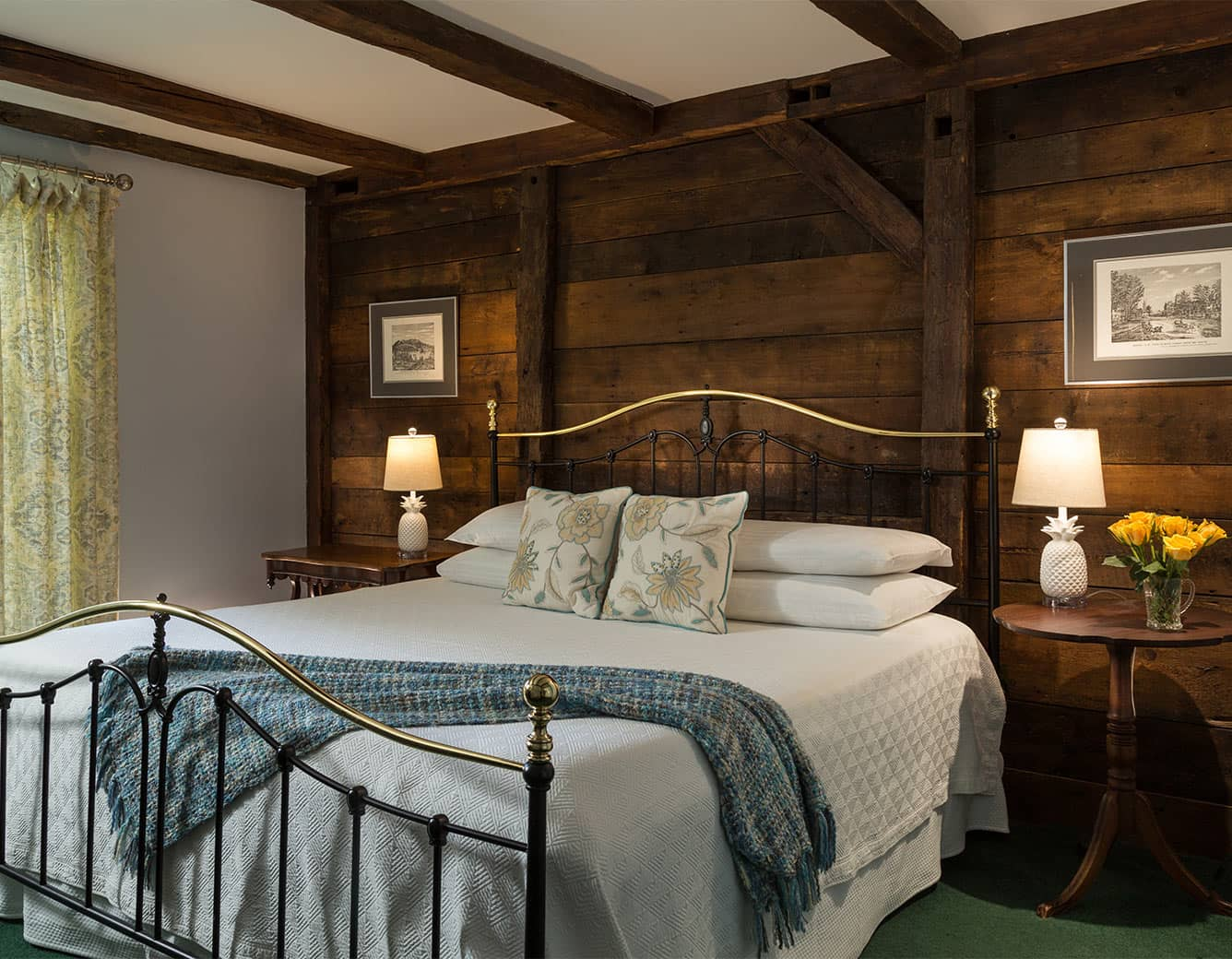 Bed in Room 10 with wood wall