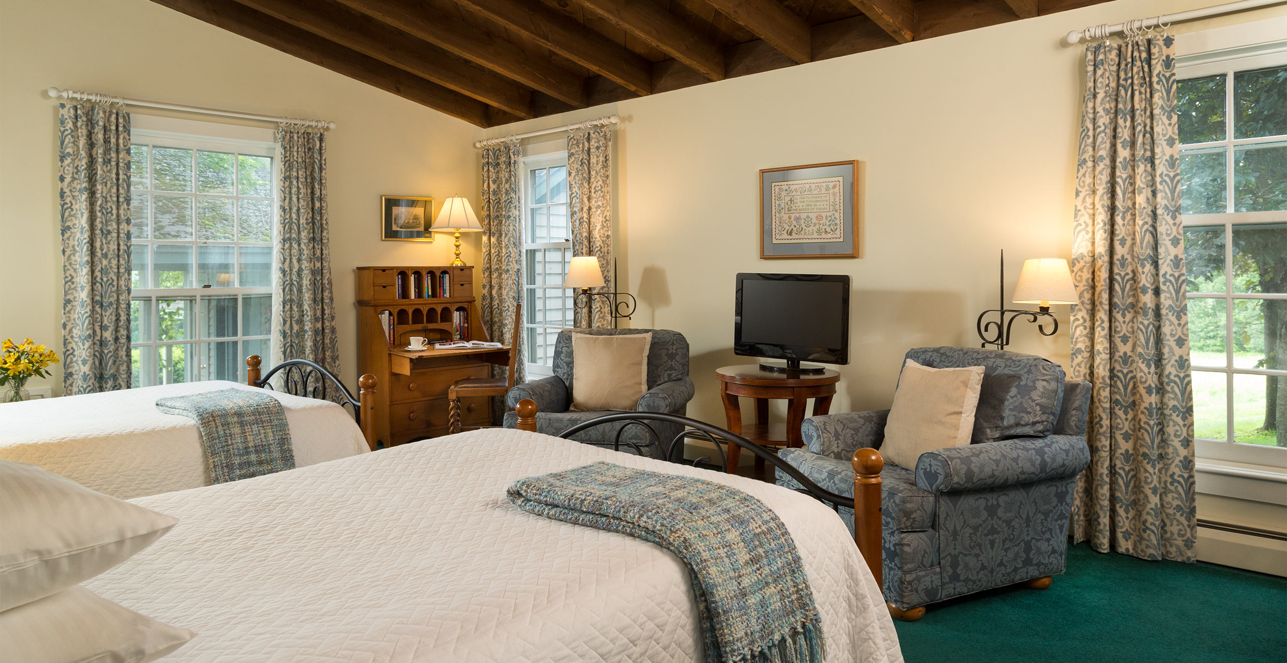 Two Beds in Room 13 with Desk and Chairs