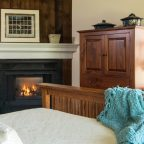 Closeup of fireplace and picture window in Room 14