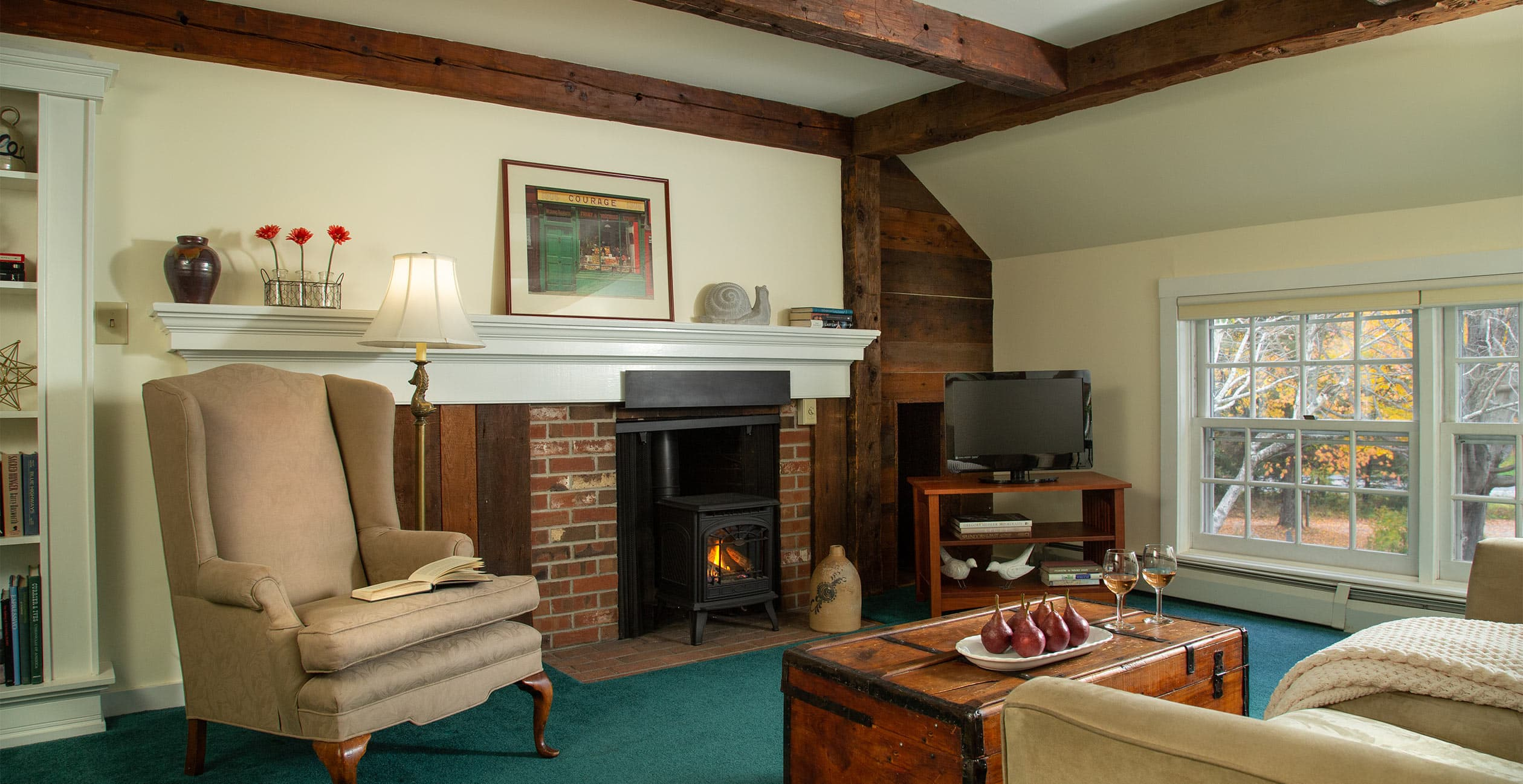 Fireplace, chair, and couch in Room 15