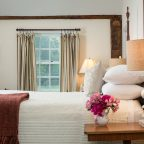 Bed with flowers on nightstand