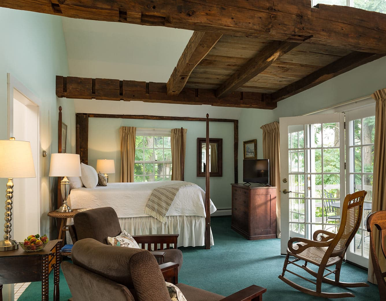 Room 17 with Bed, Barn Loft, Chairs, and French Doors