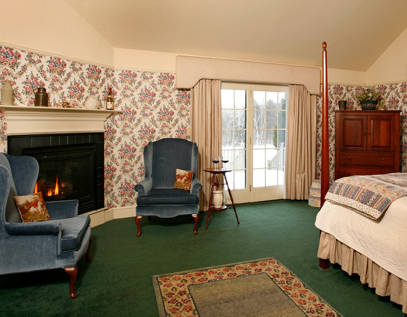 Fireplace with Two chairs, french doors, and Bed in Room 19