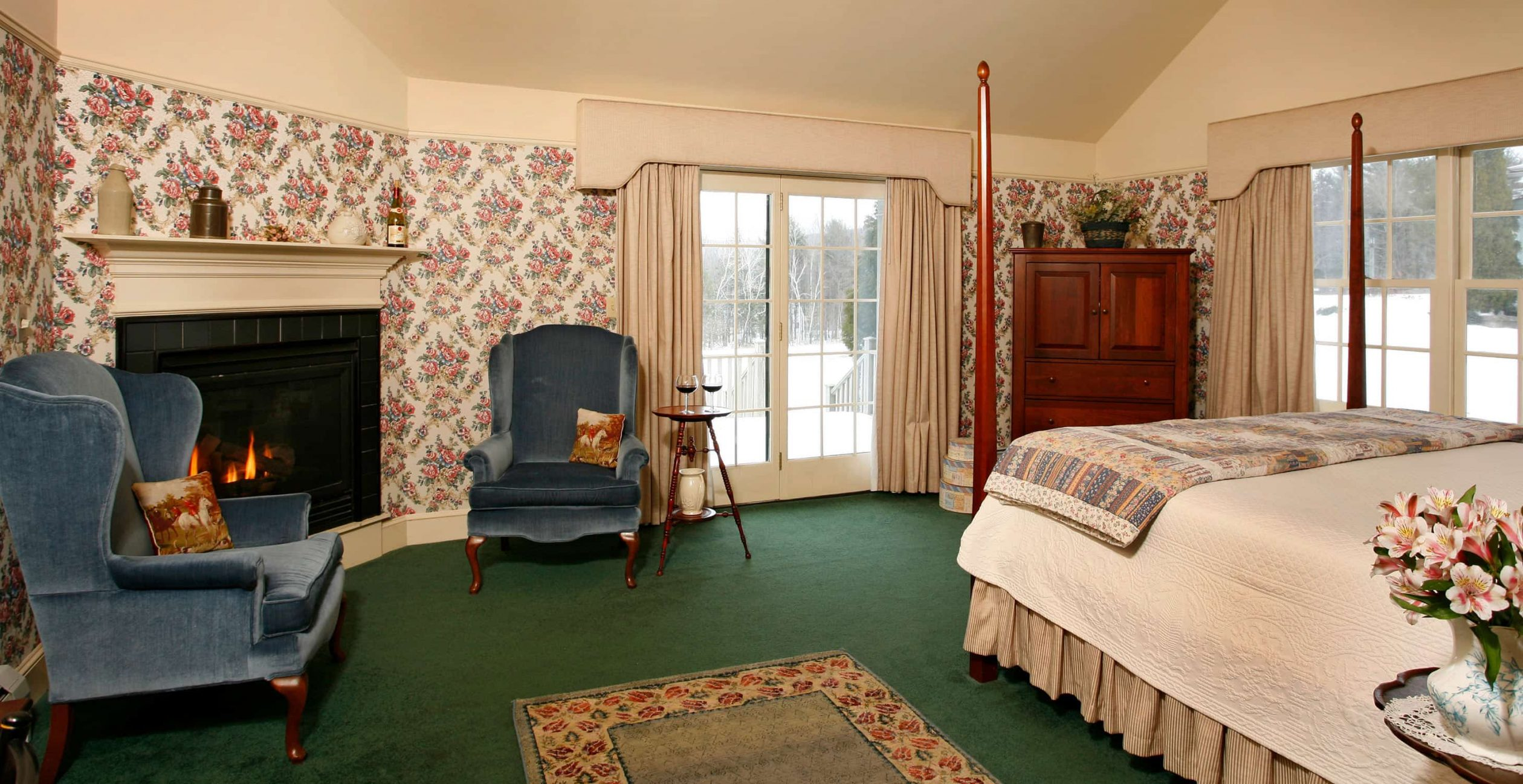 Fireplace with Two chairs and Bed in Room 19