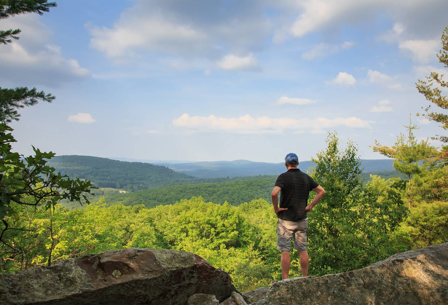 Man enjoying view after hike in New Hampshire