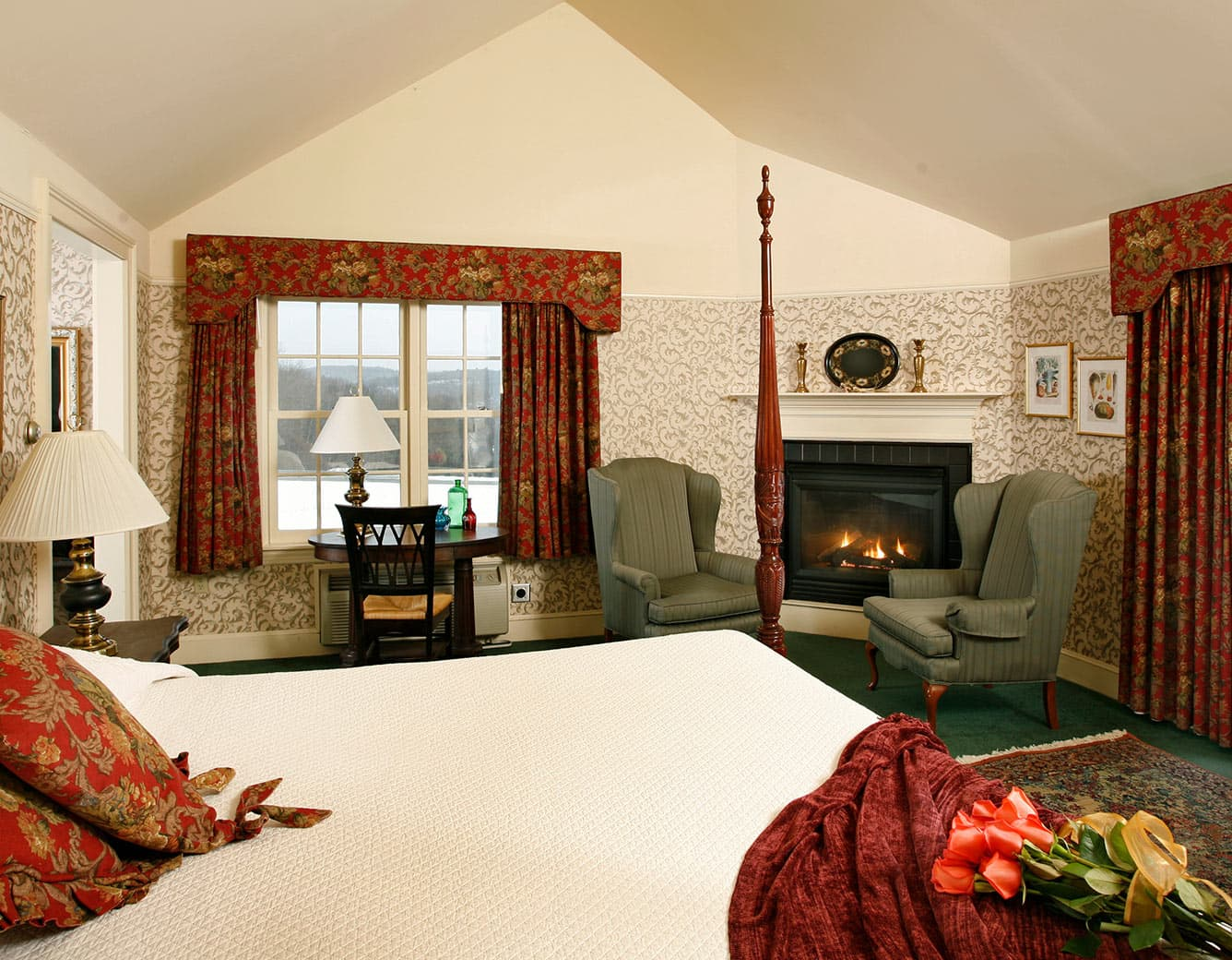 Bed, Fireplace, sitting chairs in Room 20