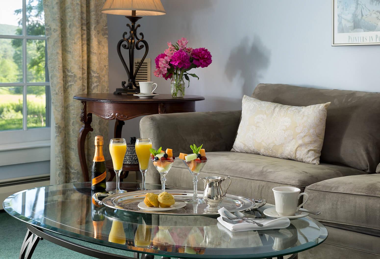 breakfast tray on coffee table in hotel room