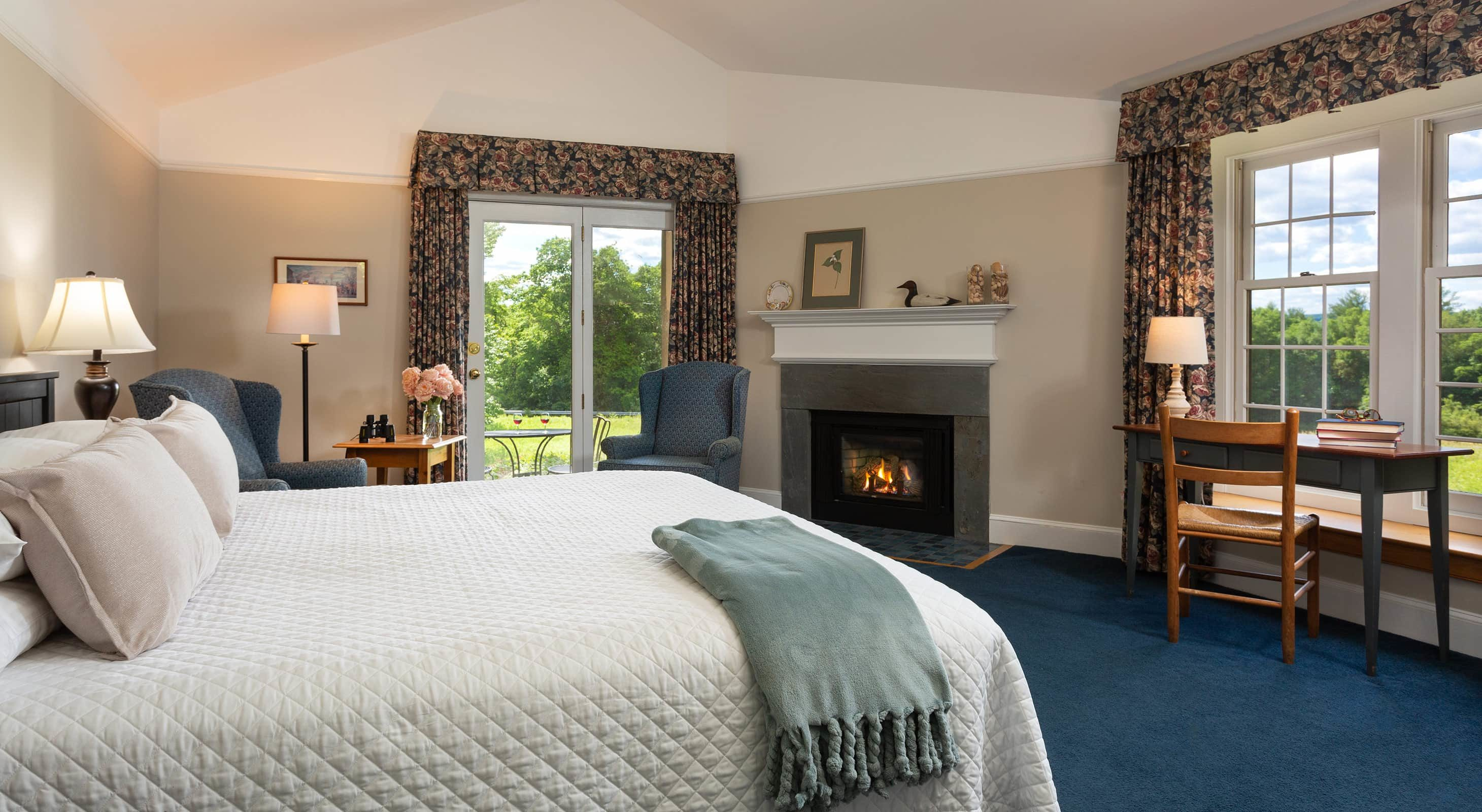 Fireplace and patio view in Room 22 - a romantic NH getaway