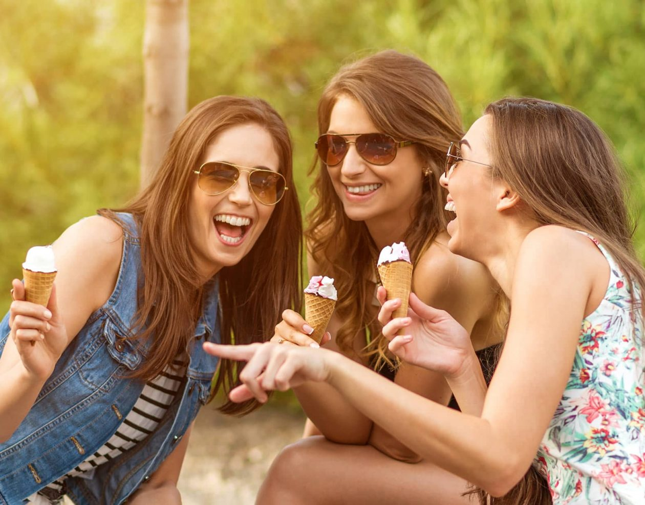 Girlfriends enjoying ice cream outdoors
