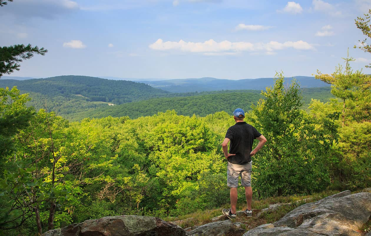 man hiking in New Hampshire