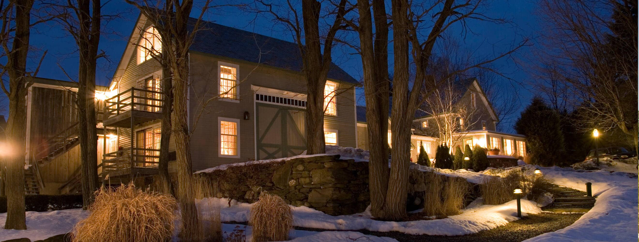 night exterior of a country inn with snow on the ground