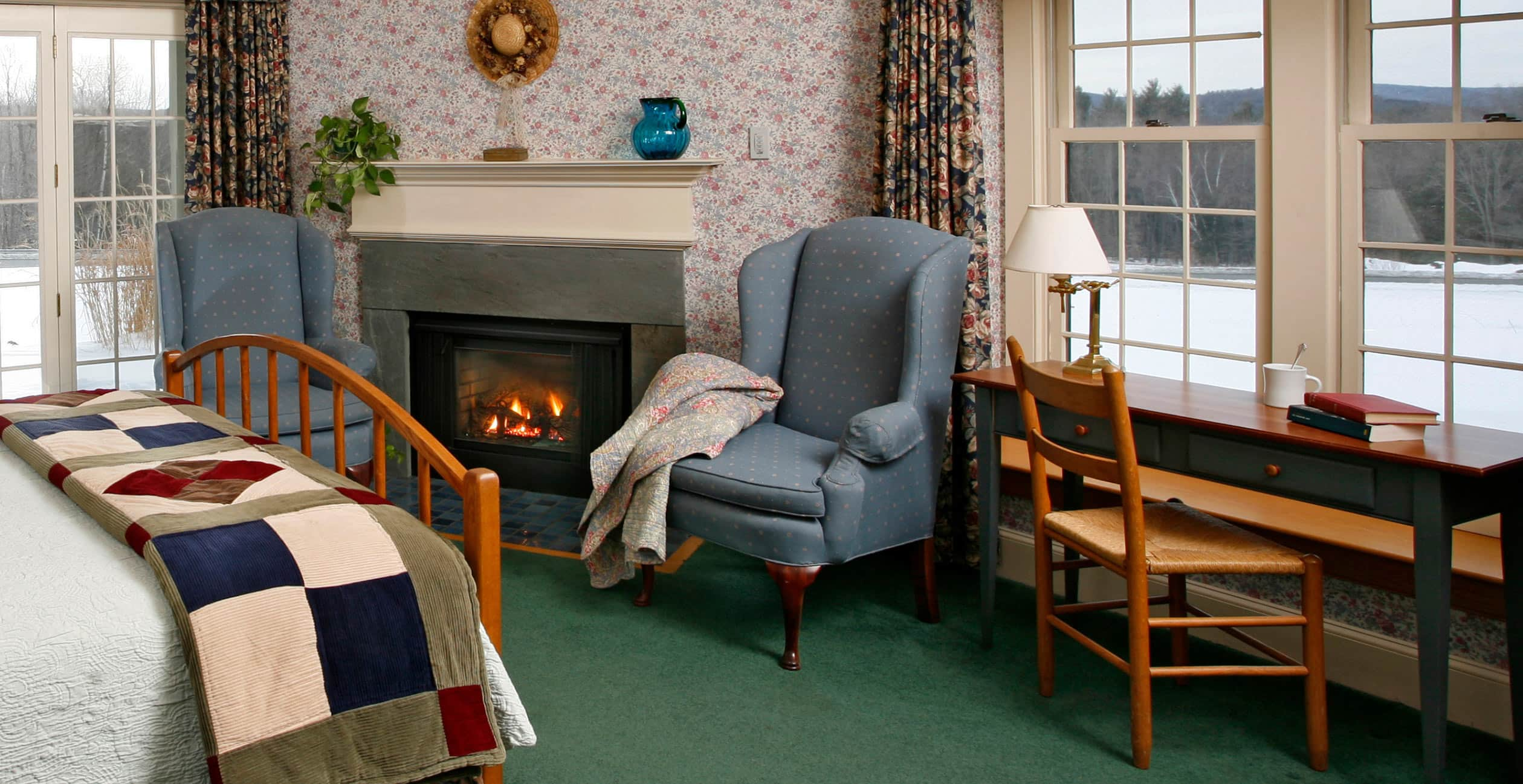 Fireplace, Two Chairs, and writing desk