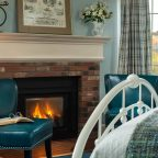 Fireplace with two blue leather chairs in front