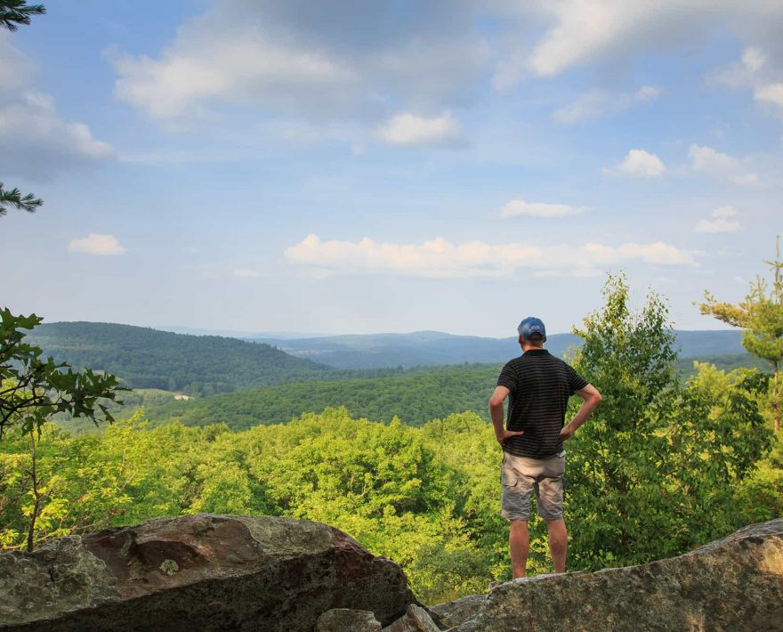 Man Hiking Ann Stokes Trail in New Hampshire