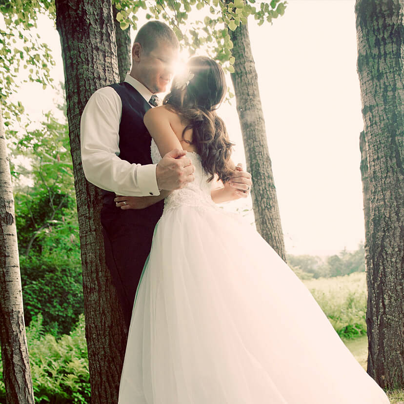 beautiful bride and groom in New Hampshire woods