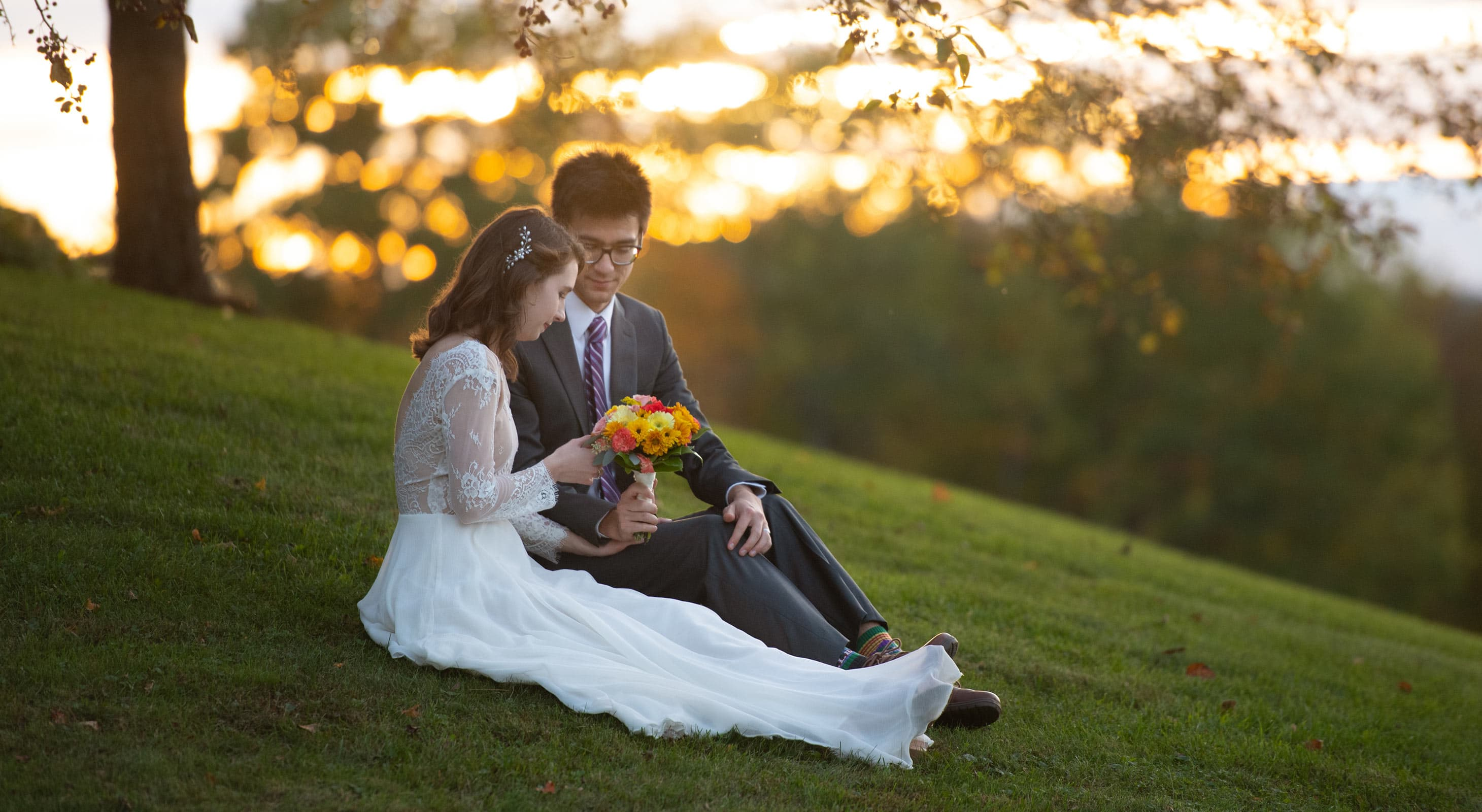 Bride and Groom on grass hill in New Hampshire