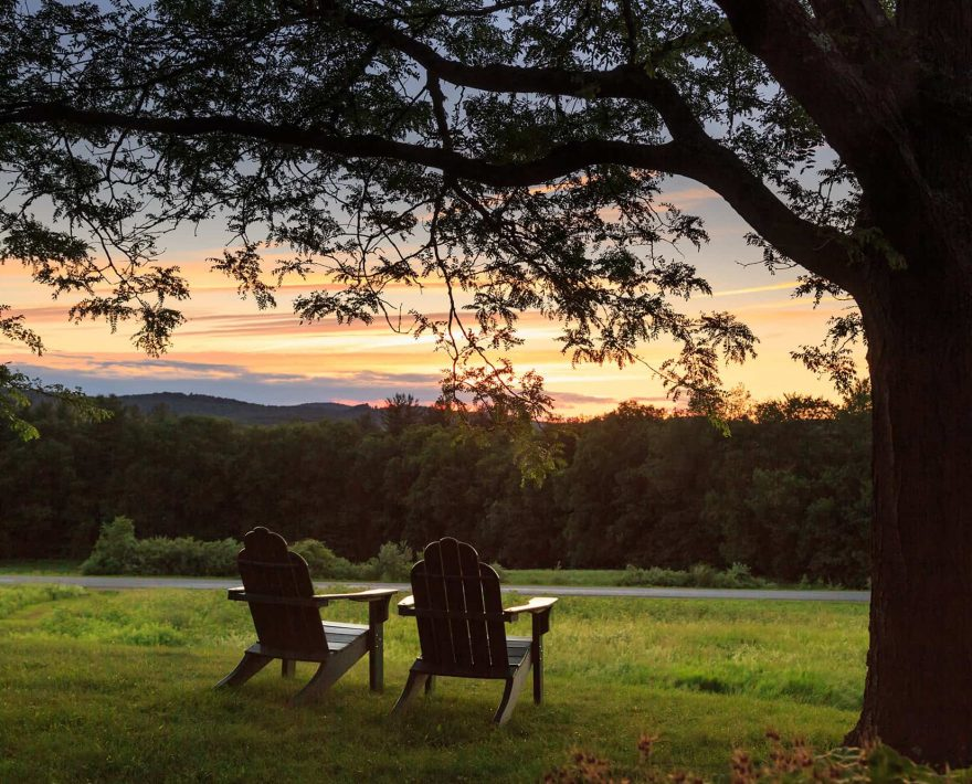 Two Adirondack chairs at sunset in New Hampshire